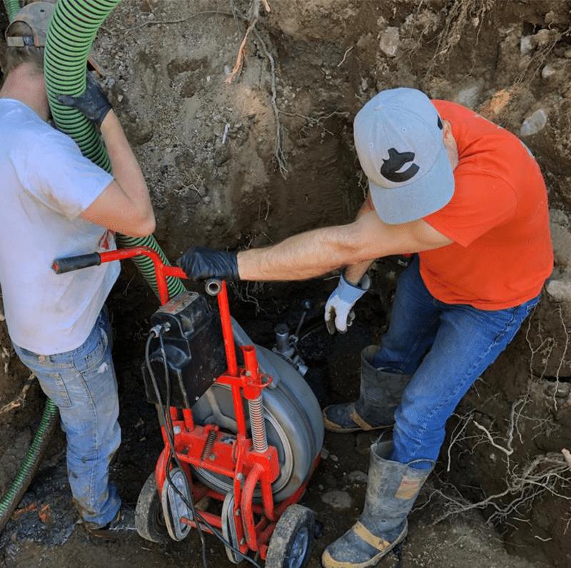 Mr Swirl technician digging a hole for a job