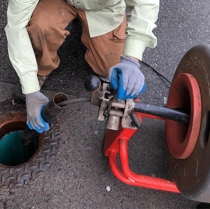 Mr Swirl technician working on a sewer mainline