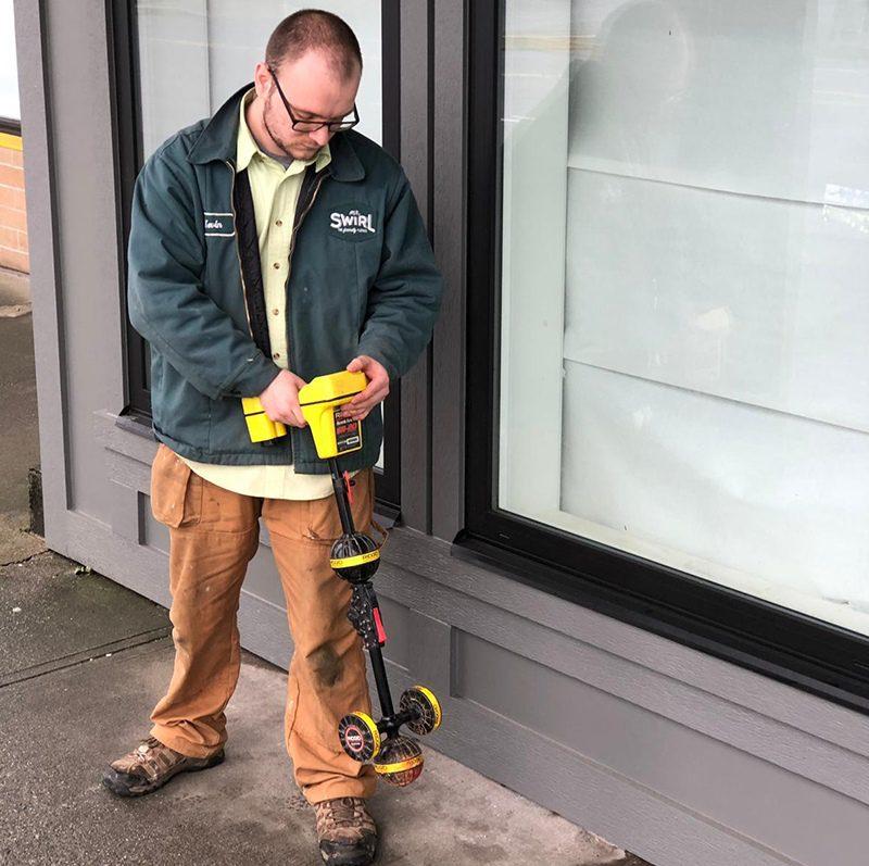 Mr Swirl technician measuring the water level