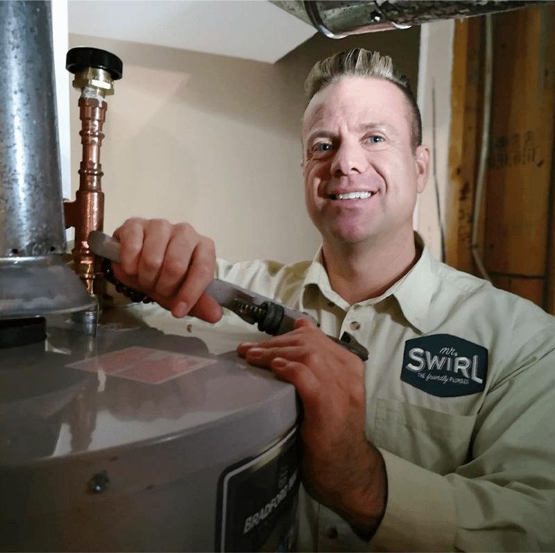 Mr Swirl technician working on a Hot Water Tank
